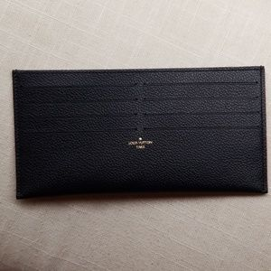 Louis Vuitton credit card holder only. Never used